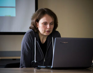 Anna Ladoshkina reading a report